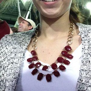 Maroon necklace.